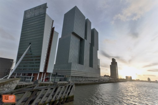View of De Rotterdam(center of the photo) by architect Rem Koolhaas, with the Toren op Zuid by architect Renzo Piano to the left and World Port Center(Foster+Partners) to the right.